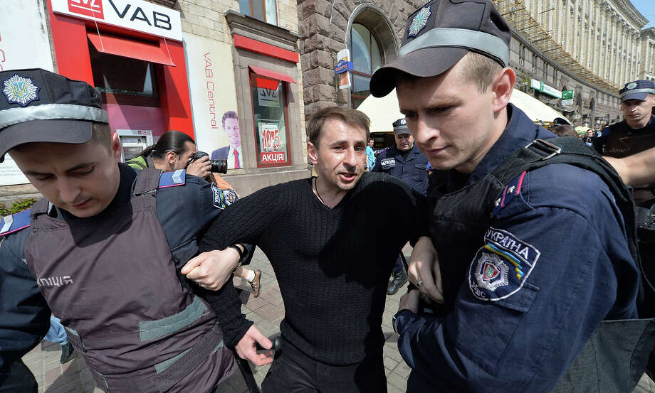 Policemen arrest a  protestor as they rally against a march of Ukrainian Communists marking May Day in Kiev on May 1, 2013. Photo: SERGEI SUPINSKY, AFP/Getty Images / 2013 AFP