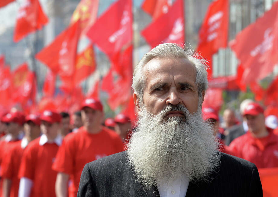 An elderly man pictured during the Ukrainian Communists march and rally marking May Day in the center of Kiev on May 1, 2013. Photo: SERGEI SUPINSKY, AFP/Getty Images / 2013 AFP