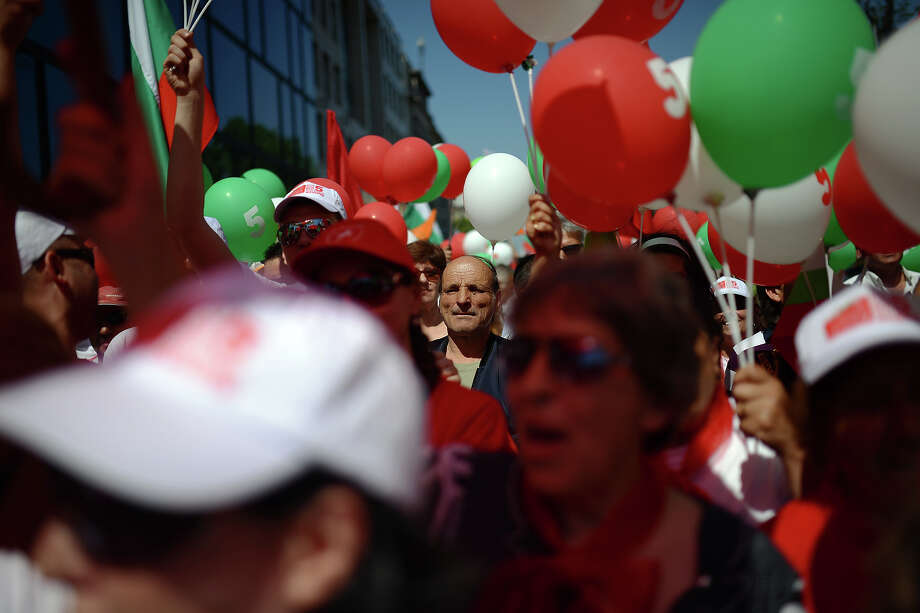 Supporters of the opposition Bulgarian Socialist Party take part in a May Day rally in Sofia on May 1, 2013. Bulgaria will holds snap parliamentary elections on May 12, 2013. Photo: DIMITAR DILKOFF, AFP/Getty Images / 2013 AFP