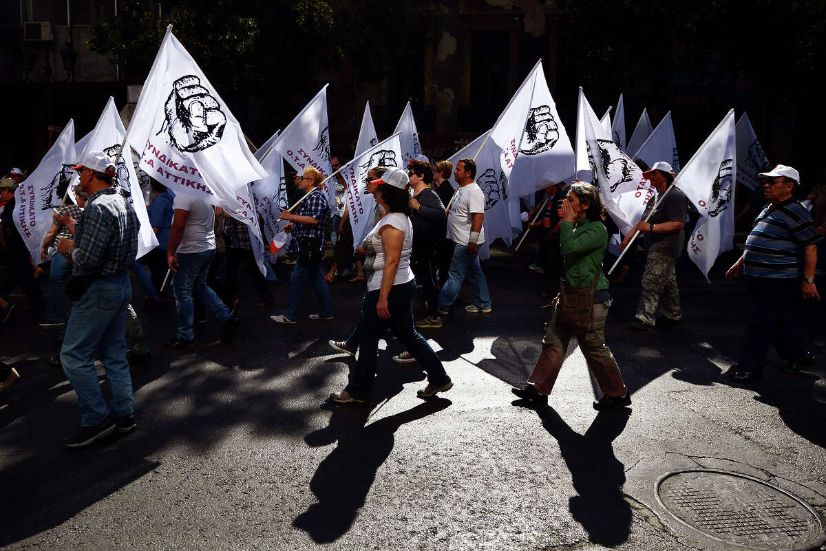 People take part in a May Day demonstration in central Athens on May 1, 2013.