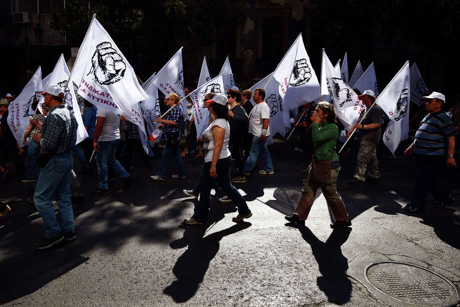 People take part in a May Day demonstration in central Athens on May 1, 2013. Photo: ARIS MESSINIS, AFP/Getty Images / 2013 AFP