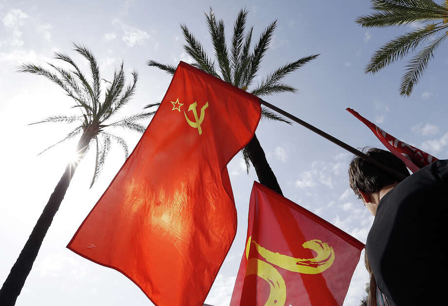 A man holds a banner of the French Communist Party who demonstrate during the workers parade as part of the May Day rallies on May 1, 2013 in Nice, southeastern France. Photo: VALERY HACHE, AFP/Getty Images / 2013 AFP