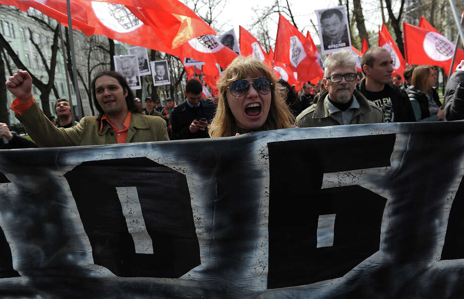 Members of leftist opposition groups take part in their traditional May Day rally in Moscow on May 1, 2013, with leftist leader and writer Eduard Limonov (2nd R) attending. Photo: ANDREY SMIRNOV, AFP/Getty Images / 2013 AFP
