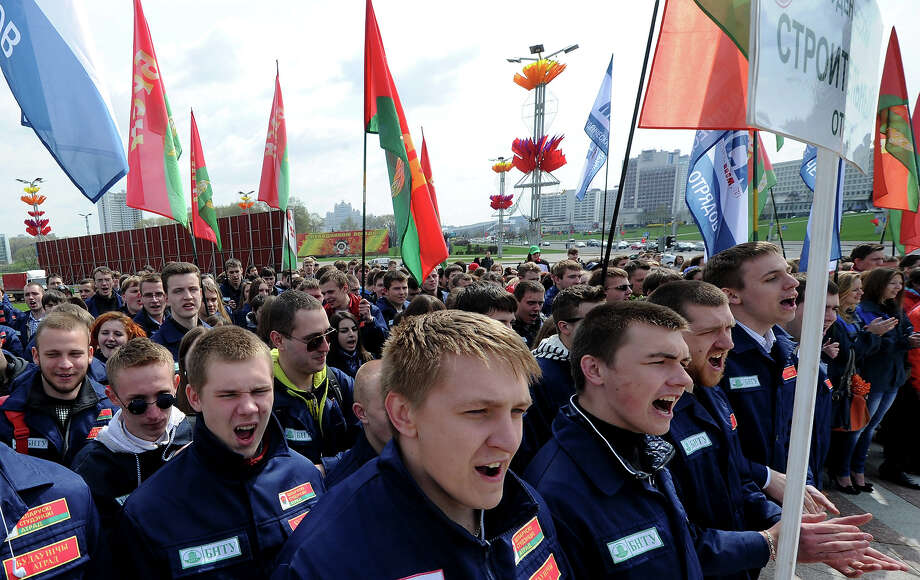Members of of the pro-government Belarusian Republican Youth Union (BRSM) attend an official May Day rally in Minsk, on May 1, 2013. Photo: VIKTOR DRACHEV, AFP/Getty Images / 2013 AFP