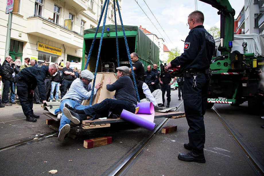 Leftist demonstrators who had tied themselves together to prevent a Neo-Nazi demonstration are moved by police on May Day on May 1, 2013 in Berlin, Germany. May Day, the international day of labour, is a national holiday in Germany and observed with gatherings by labour unions and political parties. In some cities, including Hamburg and Berlin, the day often ends with violent clashes between police and mostly left-wing demonstrators. Photo: Carsten Koall, Getty Images / 2013 Getty Images