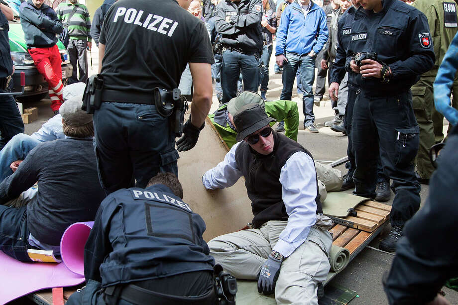 Leftist demonstrators have tied themselves together to prevent a Neo-Nazi demonstration on May Day on May 1, 2013 in Berlin, Germany. May Day, the international day of labour, is a national holiday in Germany and observed with gatherings by labour unions and political parties. In some cities, including Hamburg and Berlin, the day often ends with violent clashes between police and mostly left-wing demonstrators. Photo: Carsten Koall, Getty Images / 2013 Getty Images