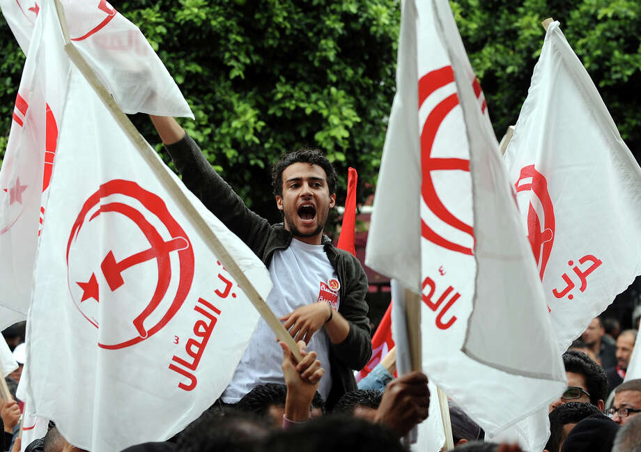 A Tunisian man shouts as he takes part in a May Day rally in the capital Tunis on May 1, 2013. Tunisian trade unions workers (UGTT) said they were expecting 6000 people to march in support of striking dock workers. Photo: FETHI BELAID, AFP/Getty Images / 2013 AFP
