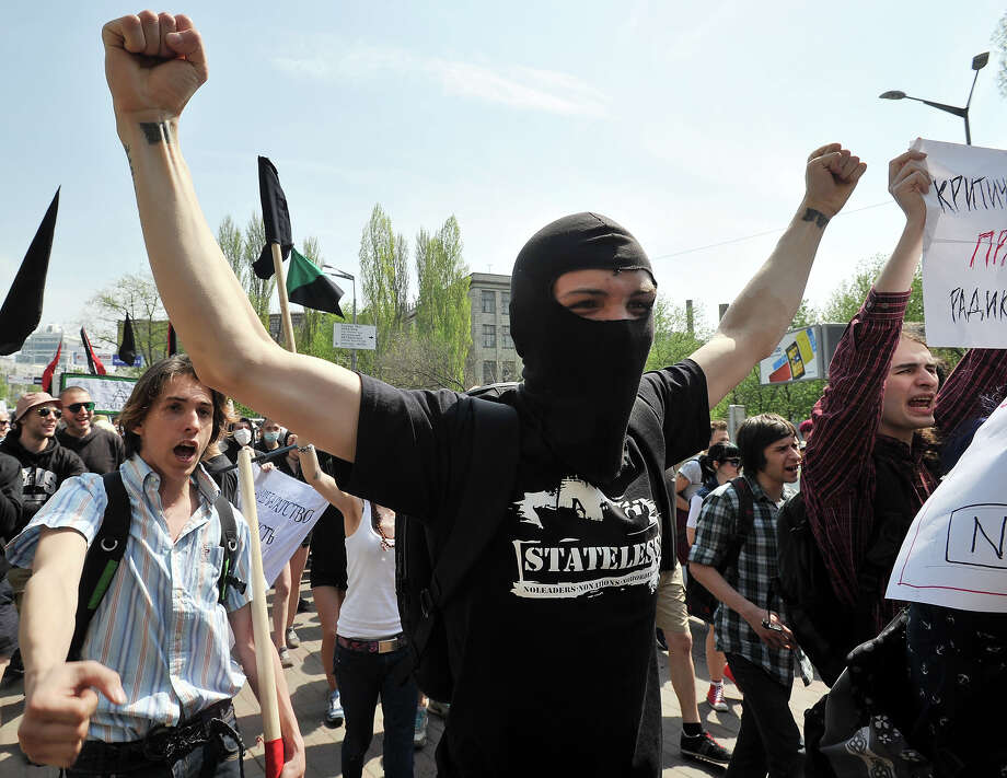 Supporters of ultra-left and anarchist parties wave hands and shout slogans during a rally marking May Day in the centre of Kiev on May 1, 2013. Photo: GENYA SAVILOV, AFP/Getty Images / 2013 AFP