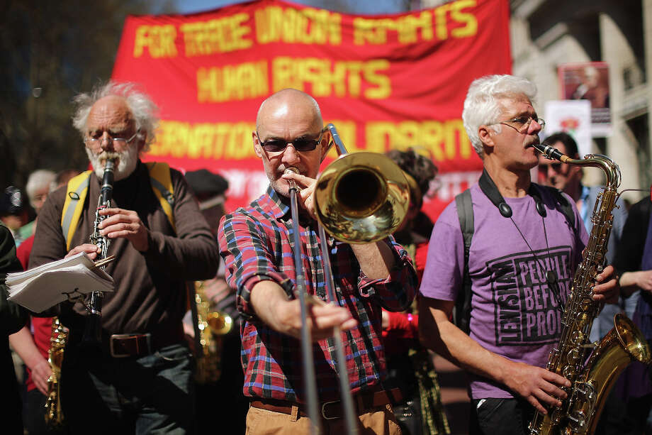 A brass band plays during the annual May Day march on May 01, 2013 in London, England. Students, trade unionists, pensioners and activists staged a march through central London before gathering in Trafalgar Square to hear speeches. Photo: Dan Kitwood, Getty Images / 2013 Getty Images