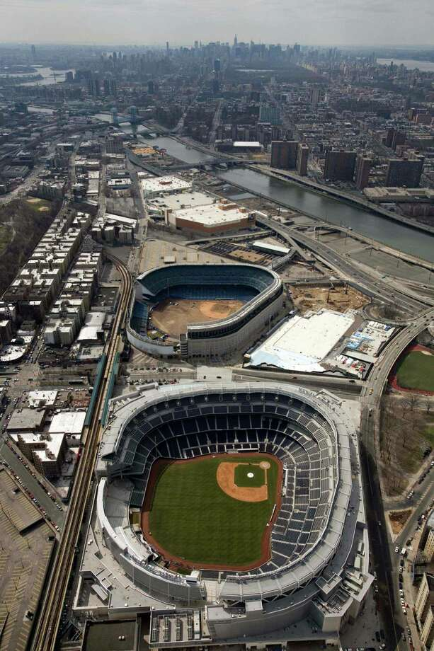 The new Yankee Stadium, foreground, and old Yankee Stadium in the Bronx. The legendary old ballpark was torn down. Photo: Mark Lennihan, AP / AP