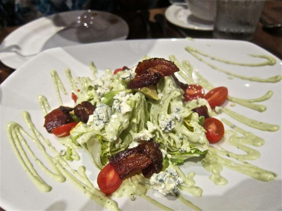 Wedge salad with avocado-buttermilk dressing, jalapeño bacon and blue cheese at La Casa del Caballo.