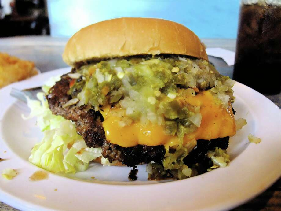 The ingredients clicked on the Outlaw Burger at Stomp's in Bacliff. Photo: Alison Cook, HC Staff / Houston Chronicle