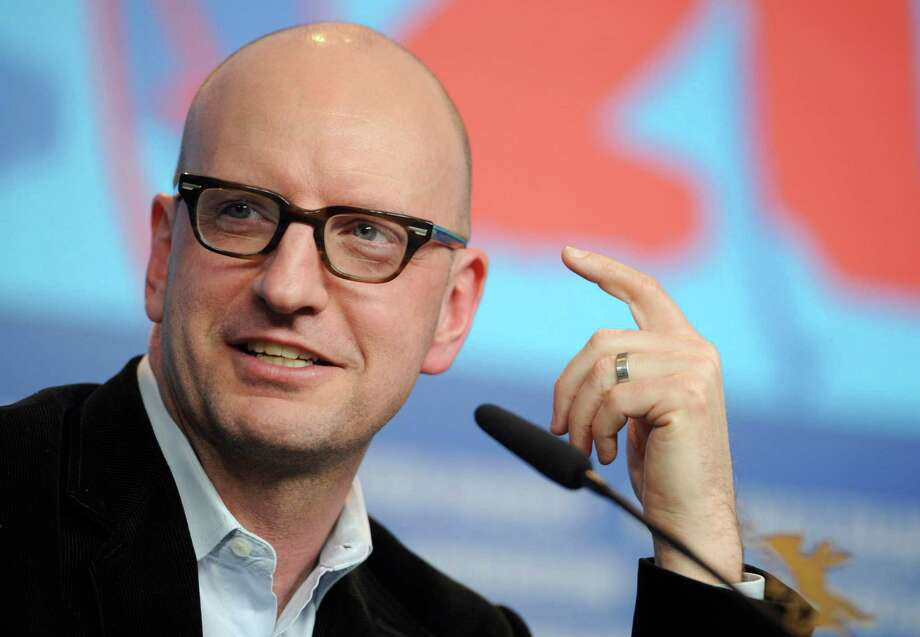 "FILE - This Feb. 15, 2012 file photo shows director, Steven Soderbergh, speaking at the press conference for his film ""Haywire,"" at the Berlin Film Festival in Berlin. Soderbergh says he is taking a sabbatical from Hollywood that could be permanent after he completes his next two films. Soderbergh directed the movie ""Magic Mike,"" which opens June 29, 2012. (AP Photo/dapd, Steffi Loos, File) Photo: Steffi Loos / AP2012"