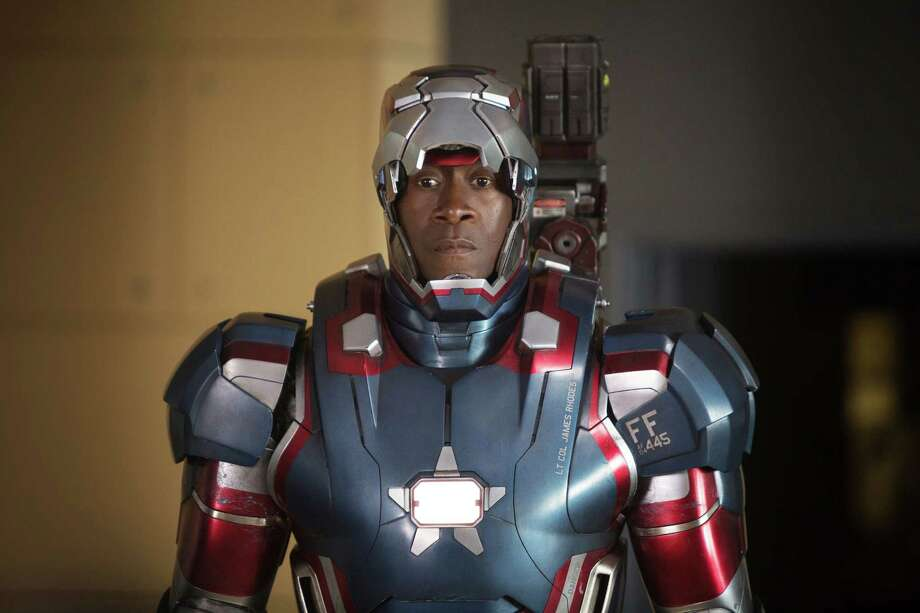 """This film publicity image released by Disney-Marvel Studios shows Don Cheadle as James Rhodes in a scene from """"Iron Man 3.""""  (AP Photo/Disney, Marvel Studios, Zade Rosenthal) Photo: Zade Rosenthal"""