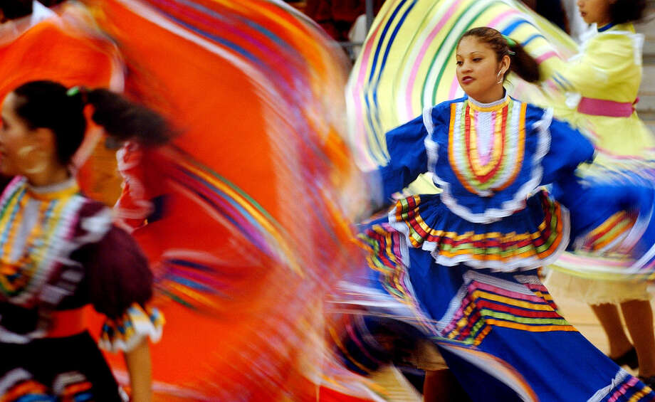 "The traditional Mexican dance called ""Son de la Negra"" is demonstrated during a Cinco de Mayo celebration in Killeen. Music and dance performances for Cinco de Mayo have helped make the Mexican holiday a universal celebration. Photo: Associated Press File Photo"