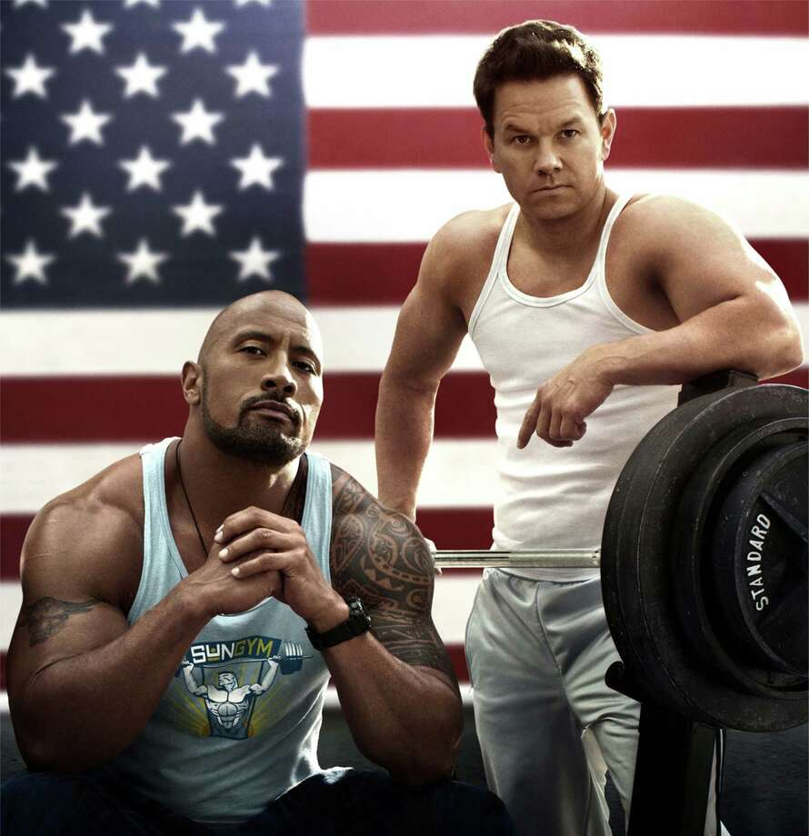"Dwayne Johnson, left, Mark Wahlberg star in ""Pain & Gain."""