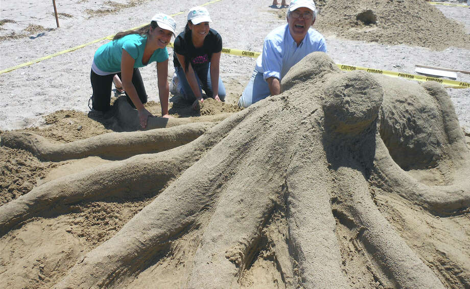 This giant octopus was crafted at the 2012 Castles in the Sand by Westport National Bank staff, from left, Jenna DelBuono, Marisol Giraldo and Victor Rossa. Photo: Mike Lauterborn, File Photo / Westport News contributed