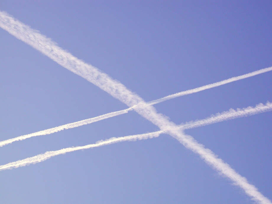 Crisscrossing chemtrails like these are caused by jets flying across one another's airspace. Photo: Forrest M. Mims III / For The Express-News