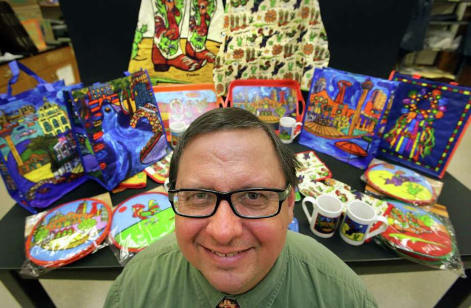 Madison High School art teacher Clif Tinker has several of his designs worked into H-E-B products, such as potholders, aprons, mugs, plates and grocery bags. Photo: Photos By Bob Owen / San Antonio Express-News
