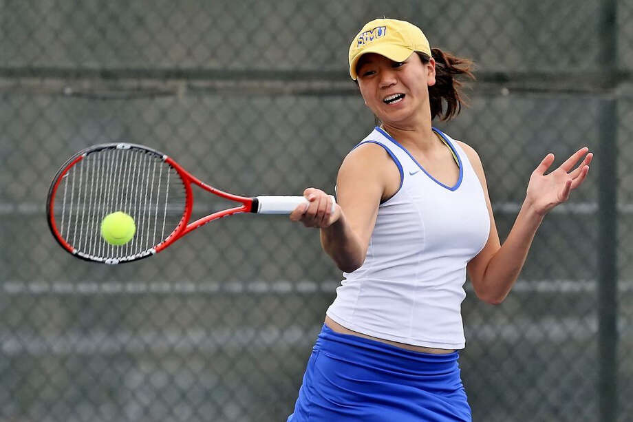 St. Mary's tennis player Mariana Rong in recent action (2013 or 2012).