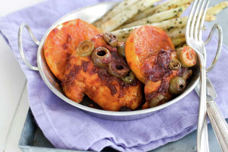 In this image taken on December 3, 2012, honey-paprika chicken with roasted oranges is shown in a bowl in Concord, N.H. (AP Photo/Matthew Mead) Photo: Matthew Mead