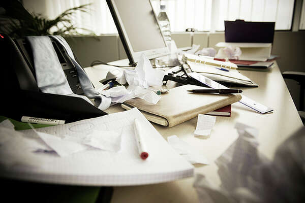Messy office space: According to a 2011 study in the Journal of Consumer Research, a messy desk can lead to a simplicity tendency that'll make you more productive on the job. These workers came up with conclusions and decisions much quicker than people in a cleaner environment. Photo: EU Social, Flickr
