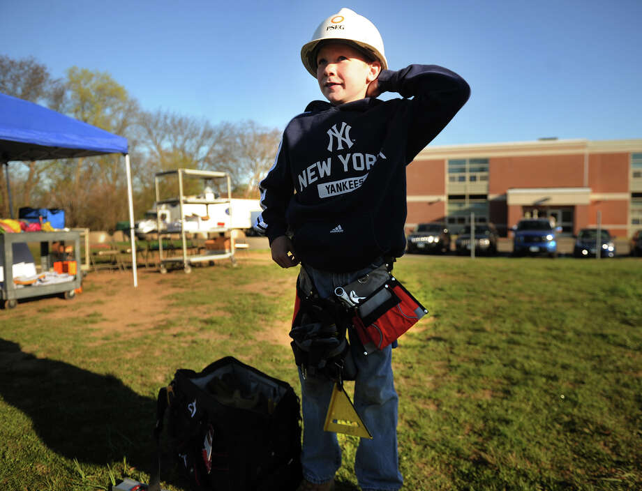 Frederick Hubbard, eight-year-old brother of slain Sandy Hook Elementary student Catherine Hubbard, dons his tool belt and hard hat to help build a playground in his sister's honor at Prendergast School in Ansonia on Wednesday, May 1, 2013. The playground is being donated to the school as part of the Sandy Ground Project, sponsored the New Jersey State Firefighter's Mutual Benevolent Association. Photo: Brian A. Pounds / Connecticut Post