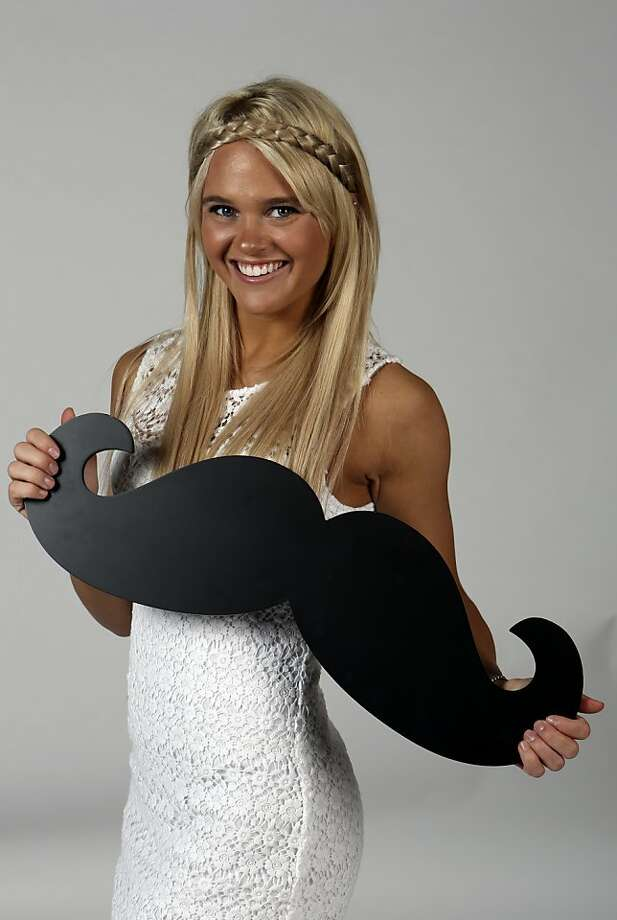 Here's to models with mustaches: Whiskers are popular again, just not on your upper lip. This handlebar 'stache held by model Katie Weitman is meant to be hung on a wall as a decoration. It's available from Hobby Lobby at Wonderland of the Americas Mall in San Antonio. Photo: Helen L. Montoya, San Antonio Express-News