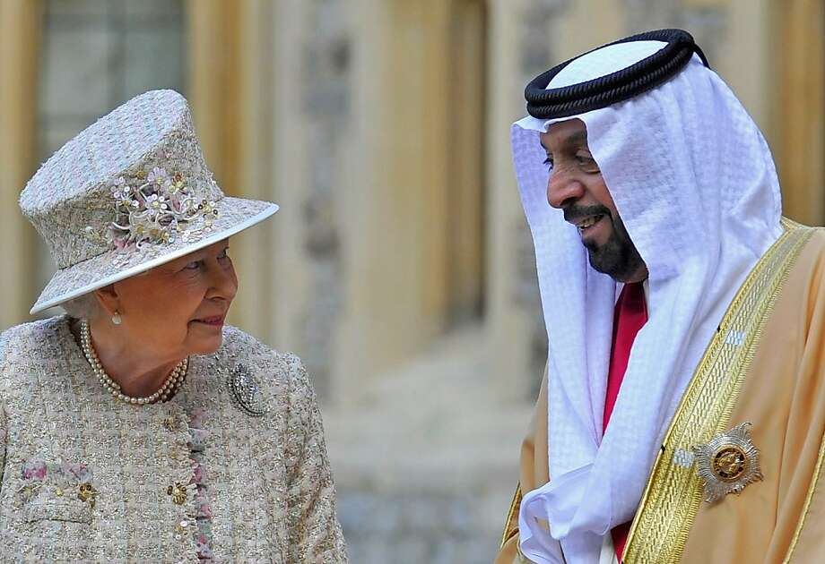 His Highness' headdress meets His Majesty's hat: Queen Elizabeth II speaks with President of the United Arab Emirates, His Highness Sheikh Khalifa bin Zayed Al Nahyan, during a ceremonial welcome in the quadrangle of Windsor Castle. Khalifa is beginning a state visit to the UK, the first for a UEA president in 24 years. Photo: WPA Pool, Getty Images