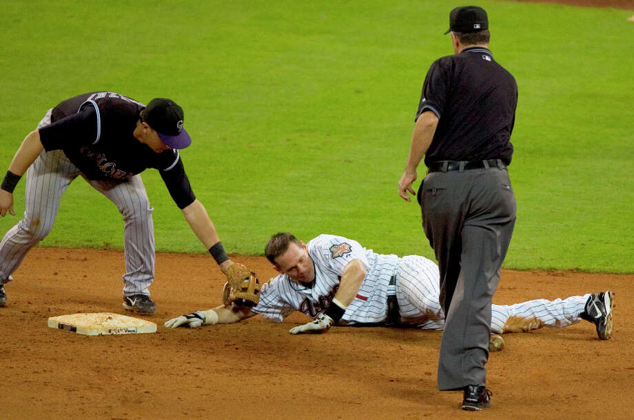 Biggio tried to stretch his 3,000th hit to a double but was tagged out by Rockies second baseman Kaz Matsui. Photo: Brett Coomer, © 2007 Houston Chronicle / © 2007 Houston Chronicle