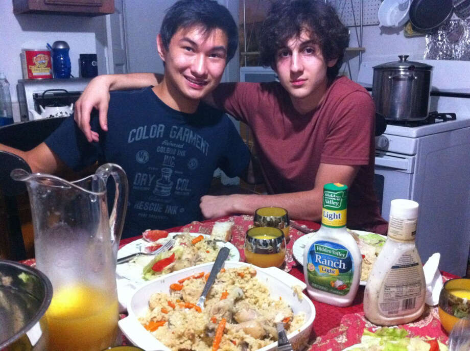 This undated photo found on the VK page of Dias Kadyrbayev shows Kadyrbayev, left, with Boston Marathon bombing suspect Dzhokhar Tsarnaev, at an unknown location. Kadyrbayev and Azamat Tazhayakov, two college buddies of Tsarnaev from Kazakhstan, were jailed by immigration authorities the day after his Tsarnaev's capture. They are not suspects, but are being held for violating their student visas by not regularly attending classes, Kadyrbayev's lawyer, Robert Stahl said. They are being detained at a county jail in Boston. Photo: VK