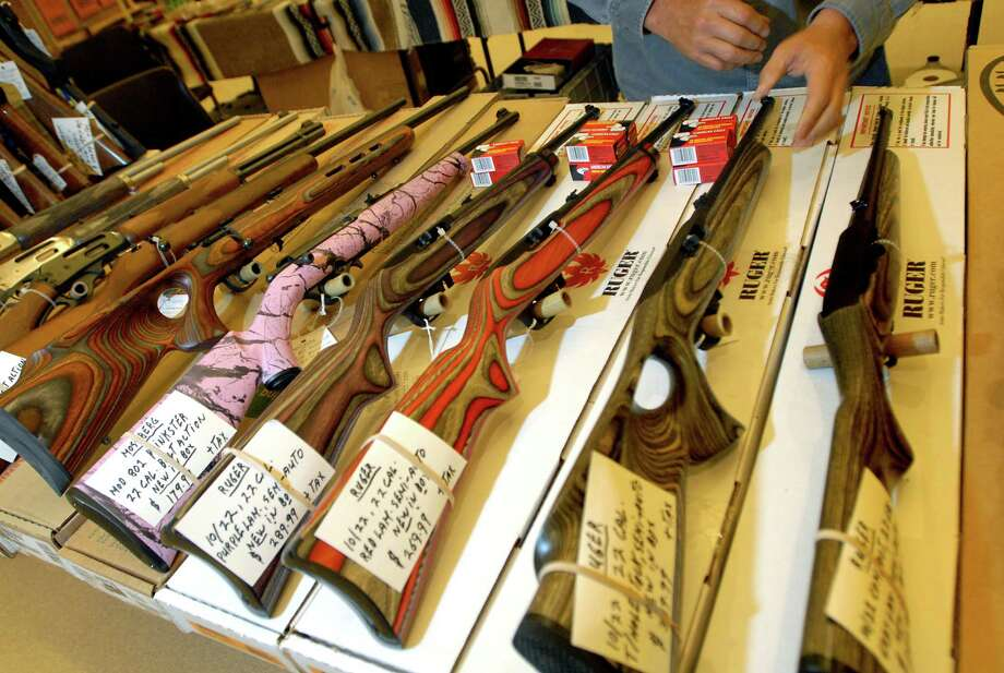 Specialty 22-caliber rifles are on display for the Arms Fair on Friday, Aug. 28, 2009, at the City Center in Saratoga Spring, N.Y. (Cindy Schultz / Times Union) Photo: CINDY SCHULTZ, ALBANY TIMES UNION / 00005229A