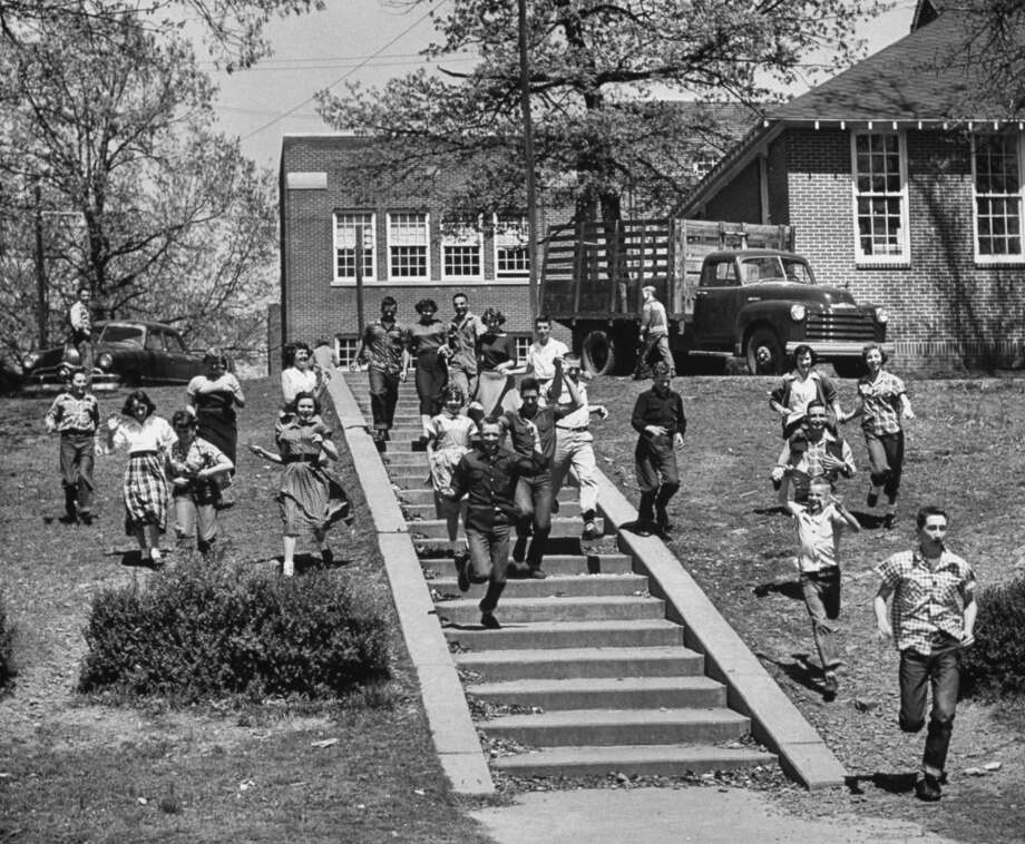 High school students race to the lunch room during springtime in Clarksville, Arkansas.(1953).  (Photo by Yale Joel//Time Life Pictures/Getty Images)