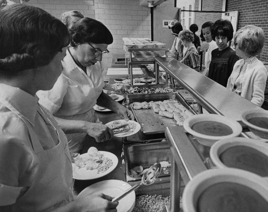 1963 - Food is dished piping hot from the serving line at Lit-ítleton High School. The cafe-íteria serves about 800 stu-ídents a day. A first class lunch keeps appetites sharp. Efficient operation can serve 200 student in 10 minutes.;  (Photo By Dave Mathias/The Denver Post via Getty Images)
