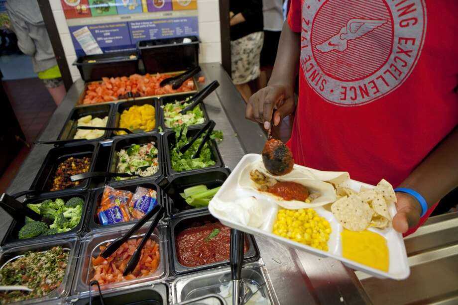 Students at Doherty Middle School get their healthy lunch at the school cafeteria, on June 18, 2012 in Andover, Massachusetts. The Andover public school district has been making a big effort to give their students healthy lunches to help combat obesity. Every day at this school students can get fresh vegetables and fruit from the salad bar, yogurt and healthy hot meals. (Photo by Melanie Stetson Freeman/The Christian Science Monitor via Getty Images)
