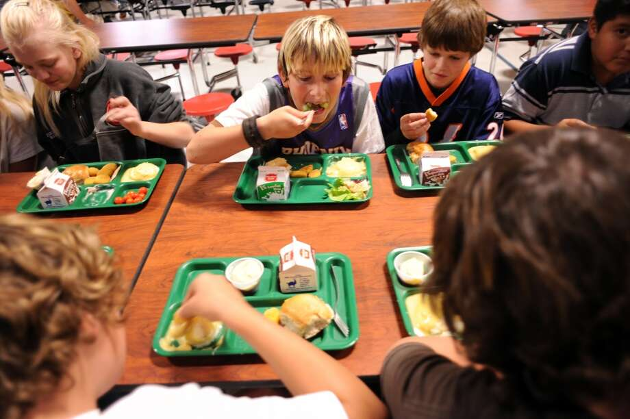 4th grade students of Wiggins School having lunch with low fat milk and vegetable with chicken nuggets in 2008. Hyoung Chang/ The Denver Post  (Photo By Hyoung Chang/The Denver Post via Getty Images)