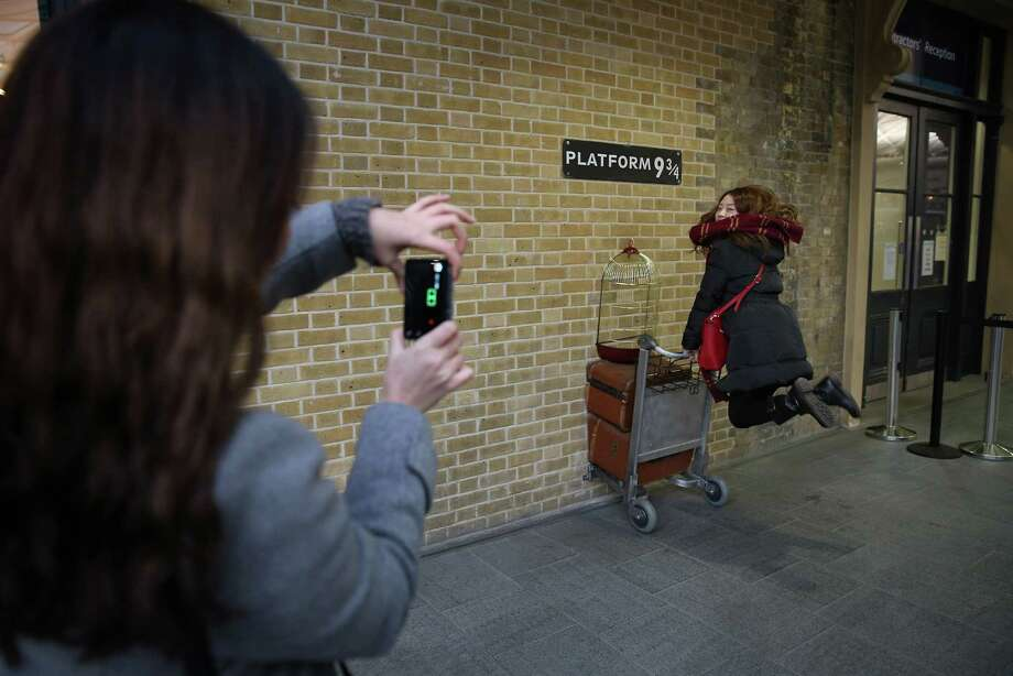 18. Original London Walks, London. This photo shows a tourist re-enacting a scene from Harry Potter at Kings Cross station. Photo: Peter Macdiarmid, Getty Images / 2013 Getty Images