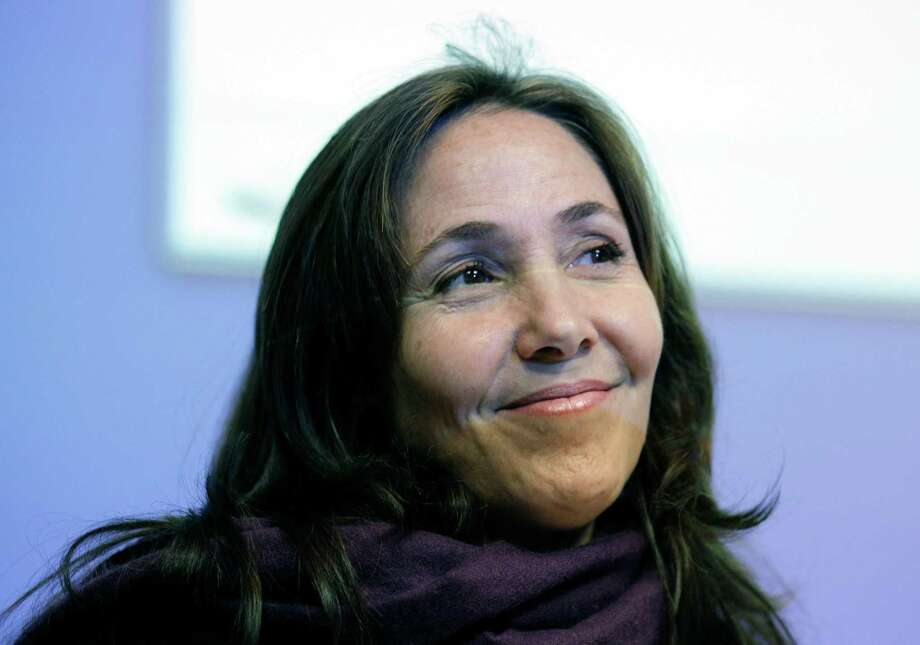 FILE - In a Wednesday, May 23, 2012 file photo, Mariela Castro, daughter of Cuban President Raul Castro, smiles before speaking to an academic conference at San Francisco General Hospital in San Francisco. Officials at the Equality Forum say Mariela Castro will attend the group's annual conference on gay rights this weekend.  The organization's executive director, Malcolm Lazin, said Tuesday, April 30, 2013 that the U.S. State Department reversed its initial decision denying a visa for Mariela Castro's visit.  (AP Photo/Eric Risberg, File) Photo: Eric Risberg