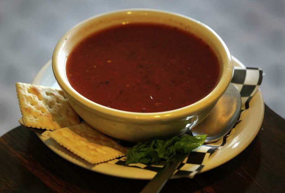 Pro: Hot foods are finally on the menu. Rain means hot foods like soup and coffee are a lot more palatable.  Photo: Bob Owen, San Antonio Express-News / ©2013 San Antonio Express-News