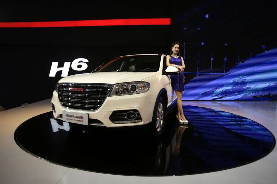 The Great Wall Haval H6 is displayed at the Shanghai International Automobile Industry Exhibition (AUTO Shanghai) media day in Shanghai, China Saturday, April 20, 2013. (AP Photo/Eugene Hoshiko)