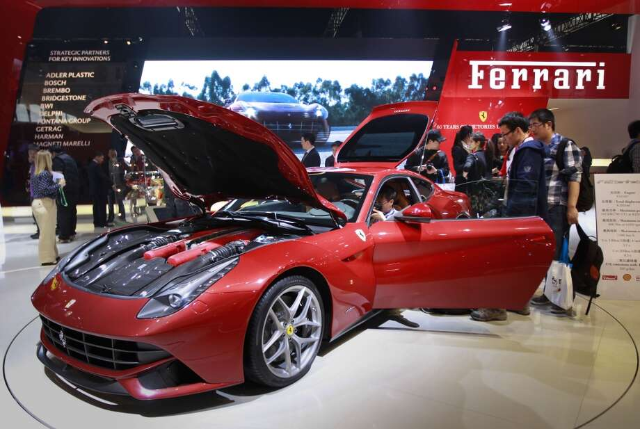 Ferrari F12 Berlinetta is on display at the Beijing International Auto Exhibition in Beijing, China, Monday, April 23, 2012.   (AP Photo/ Vincent Thian)