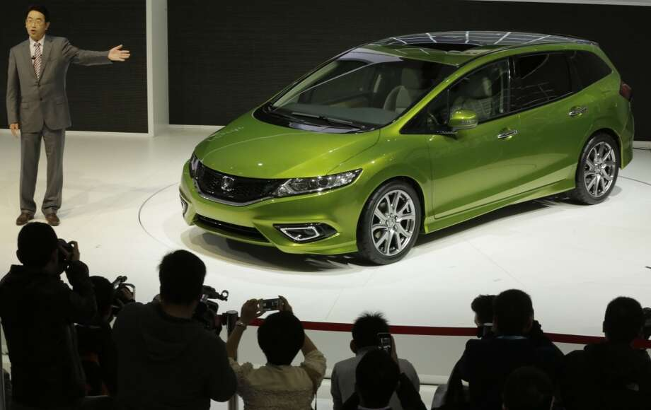 Honda Jade is unveiled at the Shanghai International Automobile Industry Exhibition (AUTO Shanghai) media day in Shanghai, China Saturday, April 20, 2013. (AP Photo/Eugene Hoshiko)