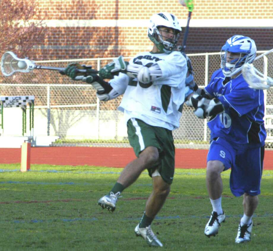 On attack  Green Wave midfielder Jameson Steinhardt winds for a shot on goal Monday, April 22 during New Milford High School boys' lacrosse's 15-4 victory over visiting Southington at NMHS. For the story and more photos, see the May 3 edition of The Spectrum and visit www.newmilfordspectrum.com. Photo: Norm Cummings