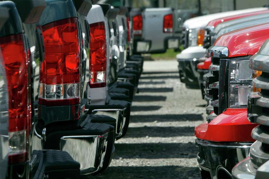 In this Thursday, April 25, 2013, photo, GMC trucks are lined up on the lot of Capitol City Buick Pontiac GMC in Montpelier, Vt. The auto industry is expected to post its best April sales totals since 2007 when major automakers report monthly tallies Wednesday, May 1, 2013. (AP Photo/Toby Talbot) Photo: Toby Talbot