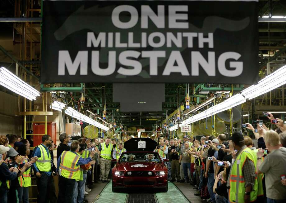 FILE - In this Wednesday, April 17, 2013, file photo Ford's Flat Rock Assembly Plant employees cheer as the millionth Ford Mustang is driven off the assembly line in Flat Rock, Mich. The Institute for Supply Management issues its U.S. manufacturing index for April on Wednesday, May 1, 2013.  (AP Photo/Carlos Osorio) Photo: Carlos Osorio