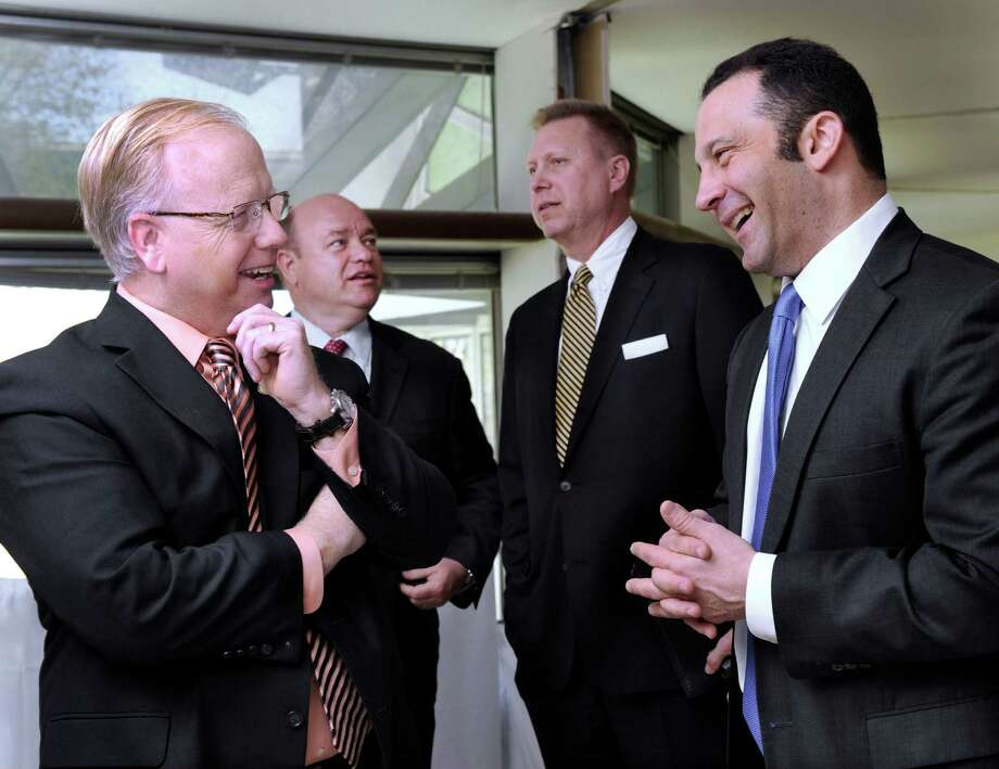 From left, Danbury Mayor Mark Boughton, Donald M. McGuire, NewOak Capital chief operating officer, Bruce Tuomala, Danbury's  economic development director and James Frishchling, president and co-founder of NewOak Capital, speak together at a gathering to announce NewOak's plans to open a subsidiary at the Matrix Corporate Center in Danbury, Conn. Wednesday, May 1, 2013. Photo: Carol Kaliff / The News-Times