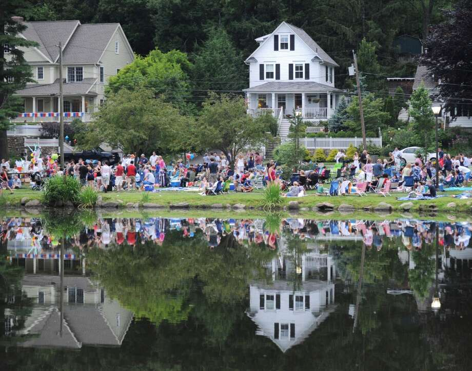 No. 5: Between the years of 1960 and 2010, the town of Greenwich grew by 14 percent, from 53,793 people to 61,171.  The crowd reflected in Binney Park Pond prior to the town fireworks display in Old Greenwich, Saturday night, July 7, 2012.