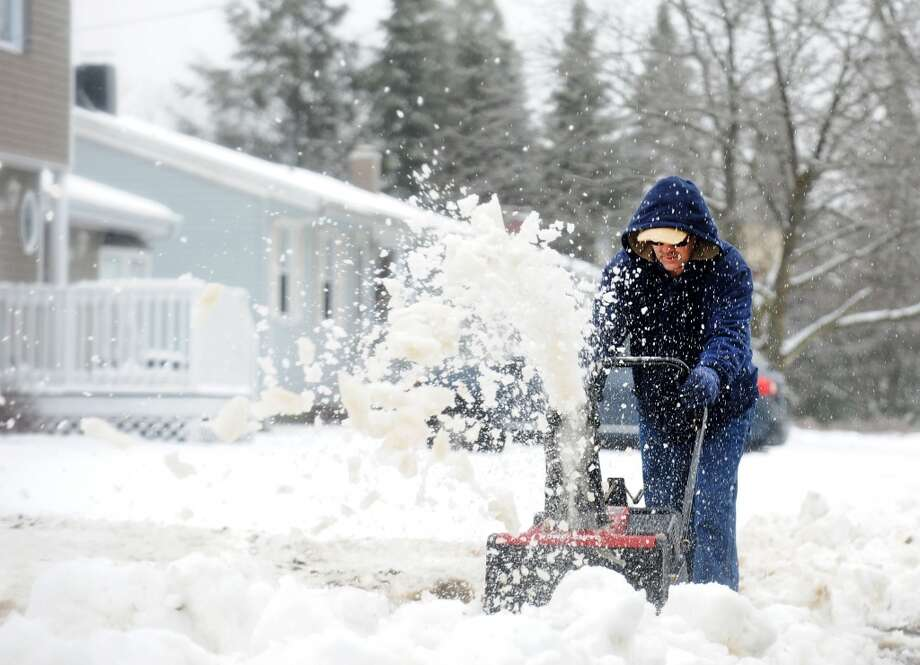 No. 3: Between the years of 1960 and 2010, the town of Derby grew by 6 percent, from 12,132 people to 12,902.  After an overnight snowfall, Lee Lennon Jr. clears his driveway on Sunset Dr. in Derby, Conn. on Tuesday March 19, 2013.