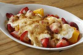 Strawberry-Orange Gratin as seen in San Francisco, California, on April 24, 2013. Food styled by Lynne Bennett.