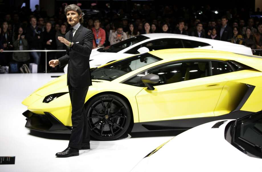 Lamborghini CEO Stephan Winkelmann unveils new Lamborghini Aventador 50th Anniversary model at the Shanghai International Automobile Industry Exhibition (AUTO Shanghai) media day in Shanghai, China Saturday, April 20, 2013. (AP Photo/Eugene Hoshiko)